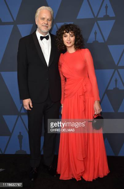 US actor Tim Robbins and Gratiela Brancusi arrive to attend the 11th Annual Governors Awards gala hosted by the Academy of Motion Picture Arts and...