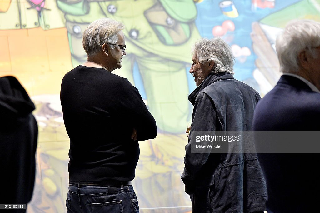 Actor Tim Robbins (L) and musician Roger Waters attend in celebration of the release of the Limited Edition box set of the film 'Roger Waters The Wall', Roger Waters hosts Los Angeles Event for Brazilian artists Osgemeos' interpretation of 'The Wall' on February 24, 2016 in Los Angeles, California.