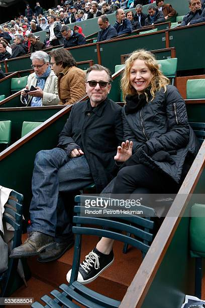 Actor Tim Roth and his wife Nikki Butler attend the 2016 French Tennis Open Day Two at Roland Garros on May 23 2016 in Paris France