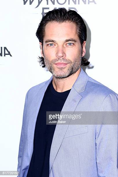 Actor Tim Rozon attends the premiere of Syfy's 'Wynonna Earp' at WonderCon 2016 at Regal LA Live Stadium 14 on March 26 2016 in Los Angeles California