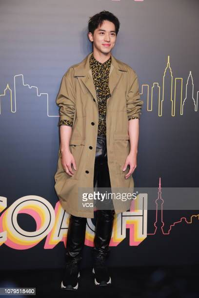 Actor Timmy Xu Weizhou poses backstage during the Coach 2019 early autumn collection fashion show 'Coach Lights Up Shanghai' on December 8 2018 in...
