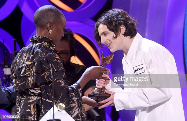 Actor Timothee Chalamet accepts Best Male Lead for 'Call Me by Your Name' from actor Danai Gurira onstage during the 2018 Film Independent Spirit...