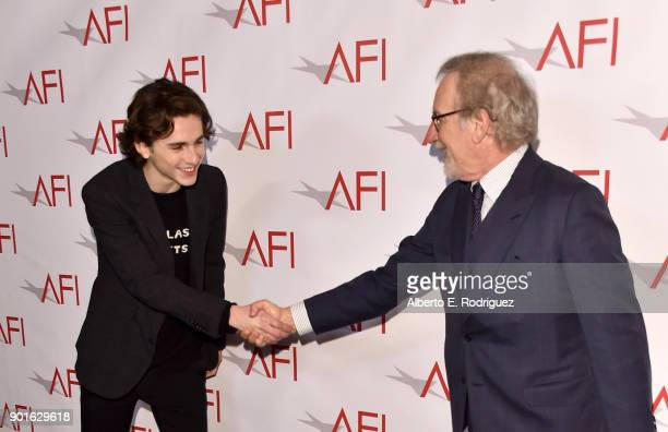 Actor Timothee Chalamet and director Steven Spielberg shake hands during the 18th Annual AFI Awards at Four Seasons Hotel Los Angeles at Beverly...