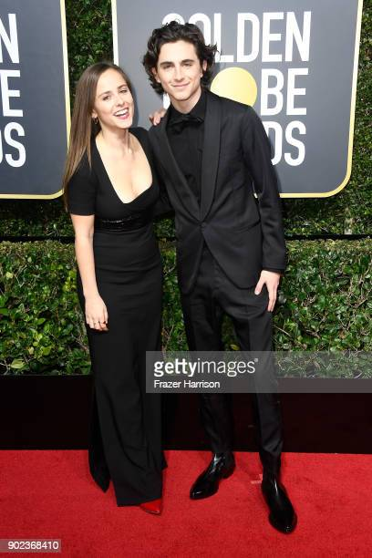 Actor Timothee Chalamet and guest attend The 75th Annual Golden Globe Awards at The Beverly Hilton Hotel on January 7 2018 in Beverly Hills California