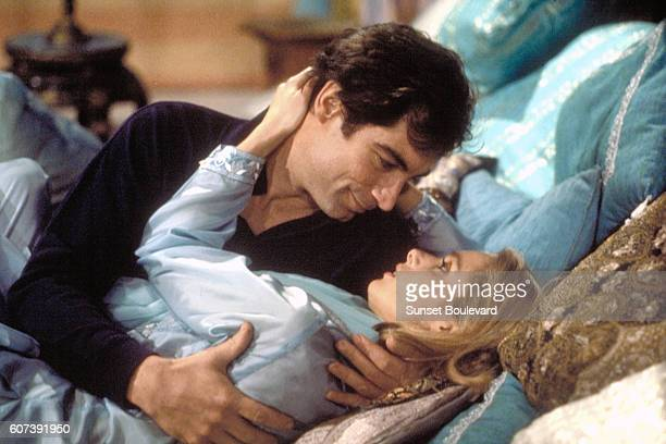 "Actor Timothy Dalton and actress Maryam d'Abo on the set of ""The Living Daylights""."