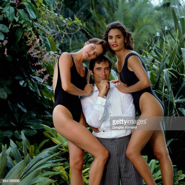 Actor Timothy Dalton is flanked by costars Carey Lowell and Talisa Soto during a photo shoot for the upcoming James Bond film Licence to Kill