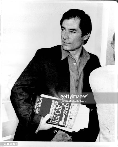 Actor Timothy Dalton the latest to play the role of James Bond 007 checks in at Sydney airport with his chosen reading matter under his arm Spy...