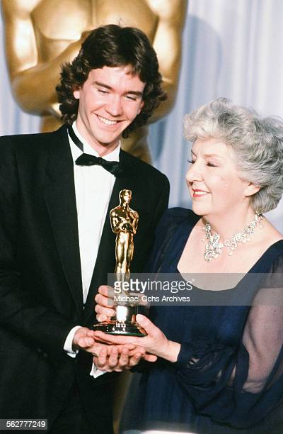 Actor Timothy Hutton and actress Maureen Stapleton pose backstage after winning Best Supporting Actress during the 54th Academy Awards at Dorothy...