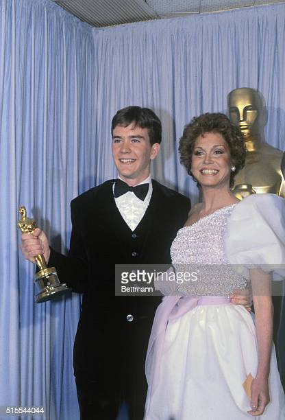 Actor Timothy Hutton holds his Oscar which he won for Best Supporting Actor which was presented to him by Mary Tyler Moore who starred with him in...