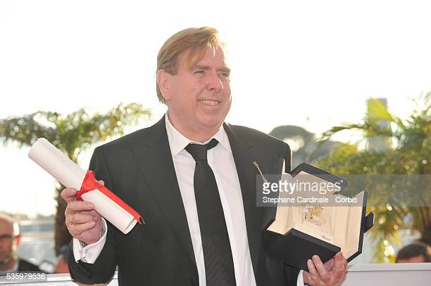 Actor Timothy Spall poses with his Best Actor award for his role in the film 'Mr Turner' at the Winners photocall during 67th Cannes Film Festival
