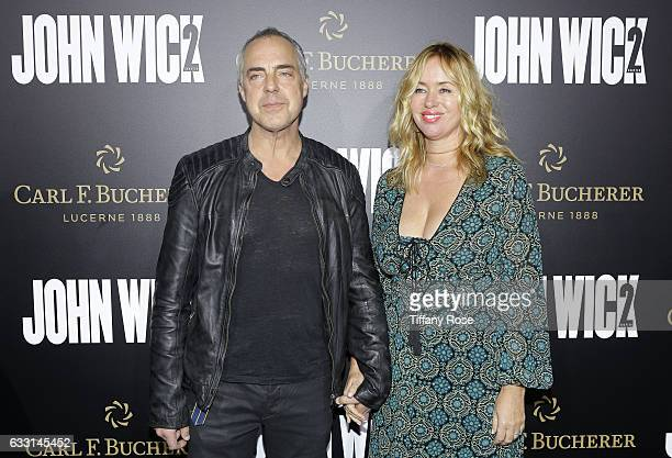 Actor Titus Welliver and Jose Stemkens attend the premiere of 'John Wick Chapter 2' sponsored by Carl F Bucherer at ArcLight Hollywood on January 30...