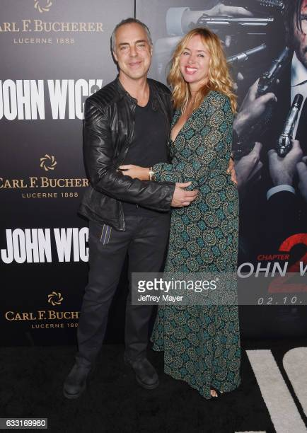 Actor Titus Welliver and Jose Stemkens attend the premiere of Summit Entertainment's 'John Wick Chapter Two' at ArcLight Cinemas on January 30 2017...