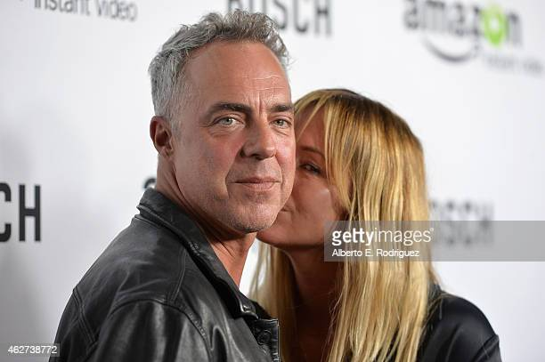 Actor Titus Welliver and Jose Welliver arrive for the red carpet premiere screening for Amazon's first original drama series 'Bosch' at The Dome at...