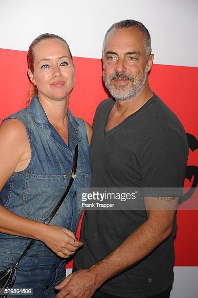 Actor Titus Welliver and wife Jose Stemkens arrive at the premiere of The Gunman held at Regal Cinemas LA Live