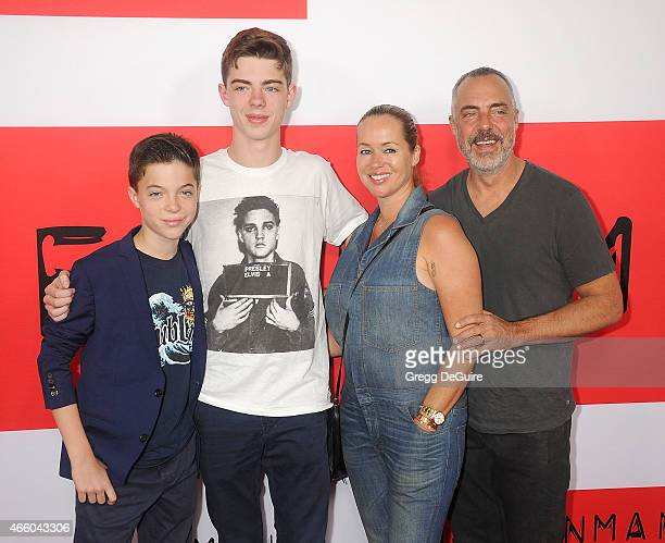 Actor Titus Welliver wife Jose Stemkens and kids arrive at the Los Angeles premiere of The Gunman at Regal Cinemas LA Live on March 12 2015 in Los...