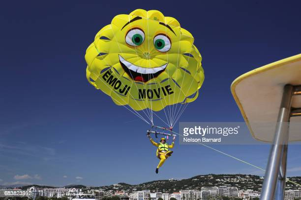 Actor TJ Miller parasails to The Emoji Movie photo call at the start of the 70th Cannes Film Festival at The Carlton Pier on May 16 2017 in Cannes...