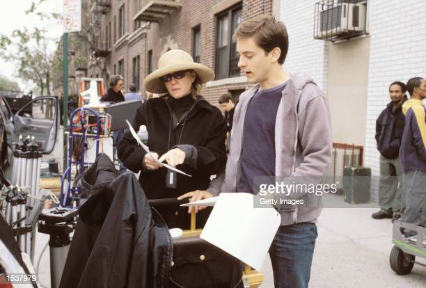 Actor Tobey Maguire and producer Laura Ziskin work on the set of the movie SpiderMan