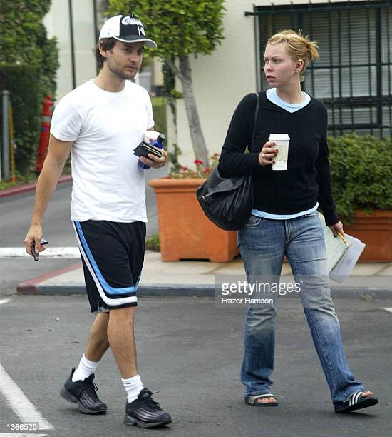 Actor Tobey Maguire and unidentified friend walk to his car after getting drinks on Sunset Plaza on August 20 2002 in Hollywood California