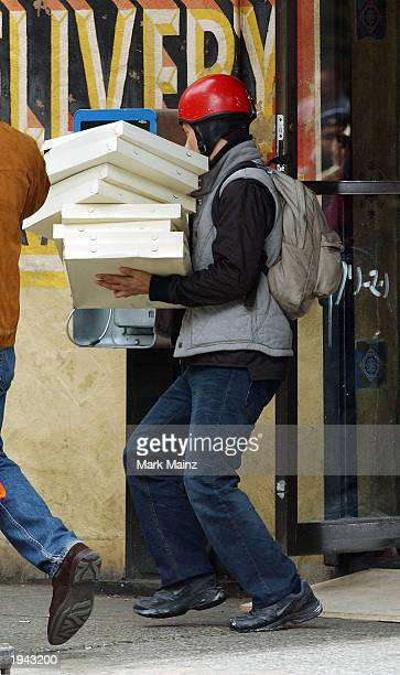 Actor Tobey Maguire portrays Peter Parker on the set of the film 'The Amazing SpiderMan' April 21 2003 in the West Village in New York City