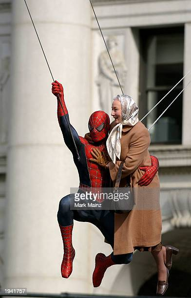 Actor Tobey Maguire's stunt double films a scene with actress Rosemary Harris on the set of the upcoming movie 'The Amazing SpiderMan' near City Hall...