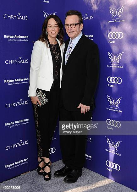 Actor Tom Arnold and Ashley Groussman arrive at the 13th Annual Chrysalis Butterfly Ball at a private Mandeville Canyon estate on June 7 2014 in Los...