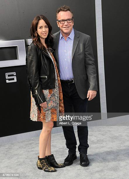 Actor Tom Arnold and Ashley Groussman arrive for the Premiere Of Paramount Pictures' Terminator Genisys held at Dolby Theatre on June 28 2015 in...