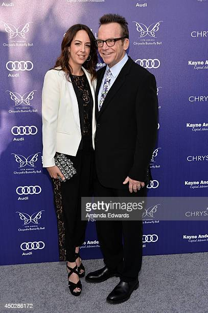 Actor Tom Arnold and his wife Ashley Groussman arrive at the 13th Annual Chrysalis Butterfly Ball at a private Mandeville Canyon estate on June 7...