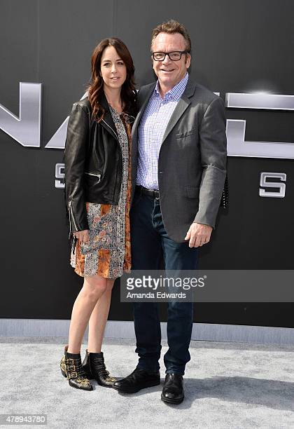 Actor Tom Arnold and his wife Ashley Groussman arrive at the Los Angeles premiere of 'Terminator Genisys' at The Dolby Theatre on June 28 2015 in...