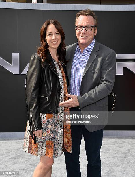 Actor Tom Arnold and his wife Ashley Groussman arrive at the Los Angeles premiere of Terminator Genisys at The Dolby Theatre on June 28 2015 in...