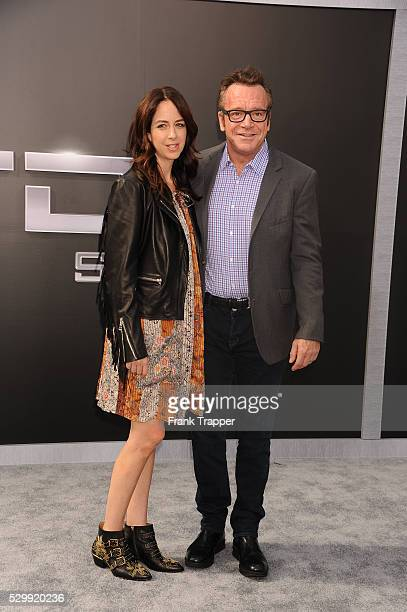 Actor Tom Arnold and wife Ashley Groussman arrive at the premiere of Terminator Genisys held at the Dolby Theater in Hollywood
