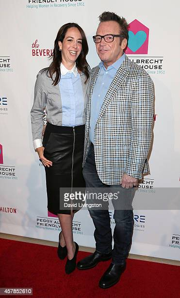 Actor Tom Arnold and wife Ashley Groussman attend the Friendly House LA Luncheon at the Beverly Hilton Hotel on October 25 2014 in Beverly Hills...