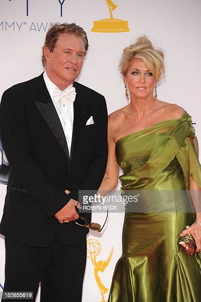 Actor Tom Berenger and his wife Laura Moretti arrive for the 64th Annual Prime Time Emmy Awards in Los Angeles California on September 23 2012 AFP...