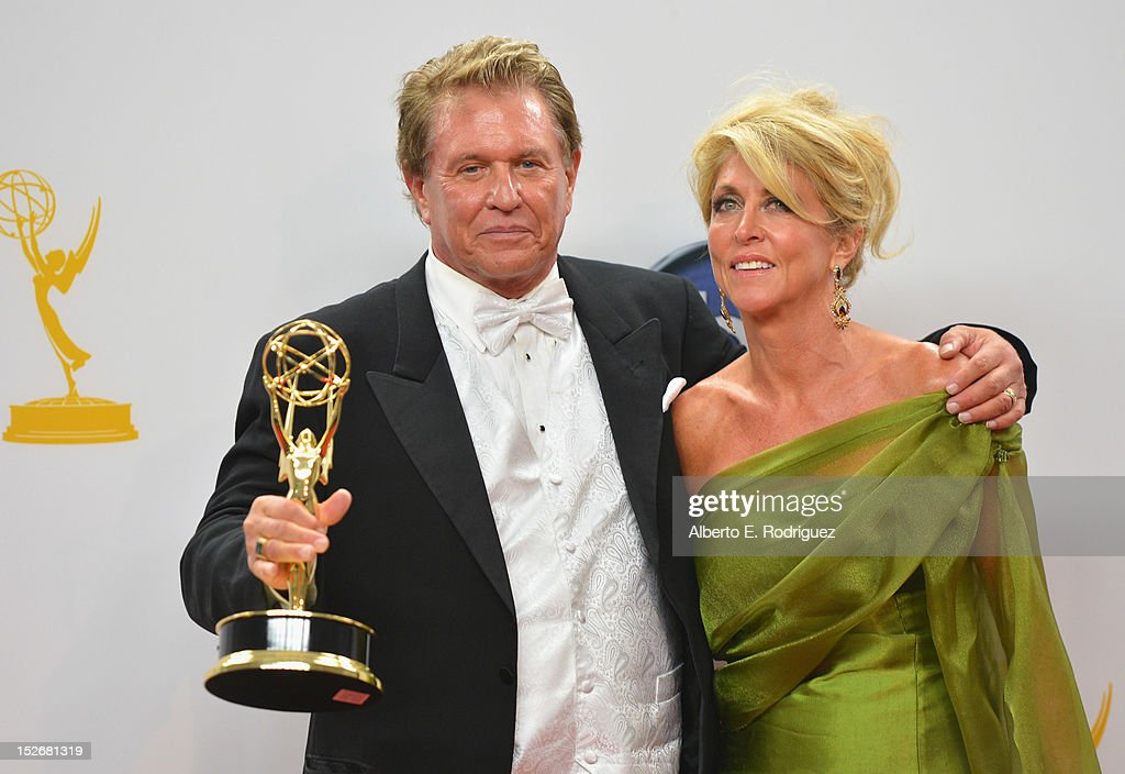 Actor Tom Berenger and Laura Moretti pose in the 64th Annual Emmy Awards press room at Nokia Theatre L.A. Live on September 23, 2012 in Los Angeles, California.