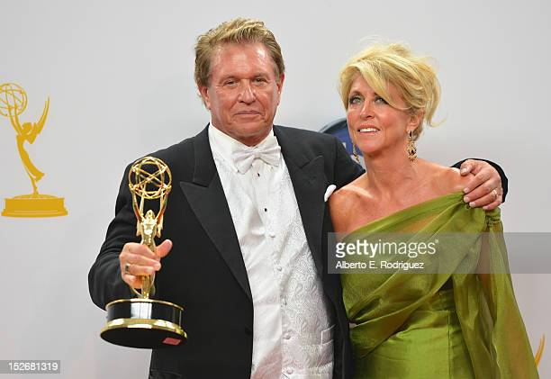Actor Tom Berenger and Laura Moretti pose in the 64th Annual Emmy Awards press room at Nokia Theatre LA Live on September 23 2012 in Los Angeles...