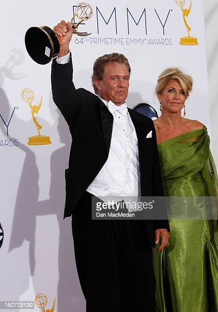 Actor Tom Berenger and Laura Moretti poses in the press room at the 64th Primetime Emmy Awards held at Nokia Theatre LA Live on September 23 2012 in...