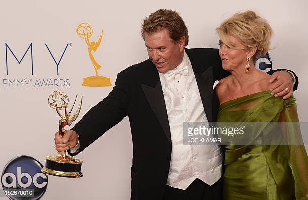 Actor Tom Berenger and wife Laura Moretti pose in the press room at the 64th annual Prime Time Emmy Awards at the Nokia Theatre at LA Live in Los...