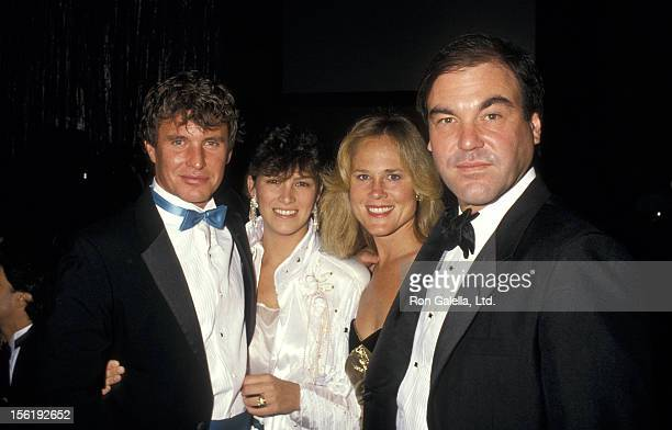 Actor Tom Berenger and wife Lisa Berenger and director Oliver Stone and wife attend 39th Annual Director's Guild Awards on March 7 1987 at the...