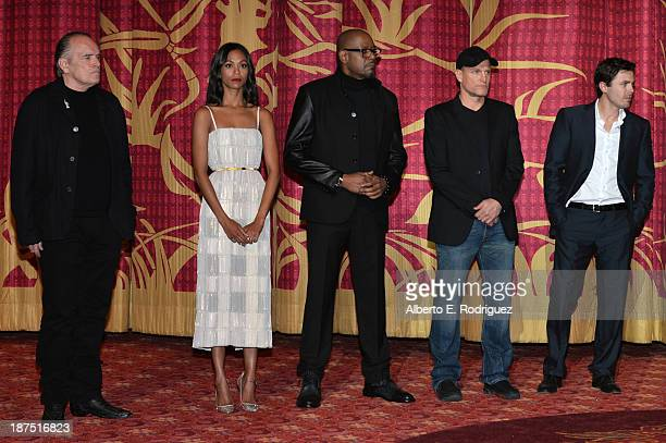 Actor Tom Bower actress Zoe Saldana actor Forest Whitaker actor Woody Harrelson and actor Casey Affleck attend the screening of Out of the Furnace...