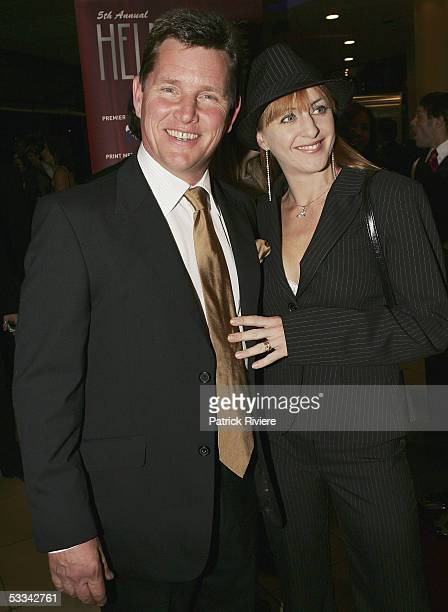 Actor Tom Burlinson arrives with his wife Mandy Carnie for the Helpmann Awards at the Lyric Theatre Star City on August 08 2005 in Sydney Australia...
