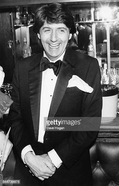 Actor Tom Conti laughing as he attends the Society of West End Theatre Awards at Grosvenor House Hotel London December 10th 1984