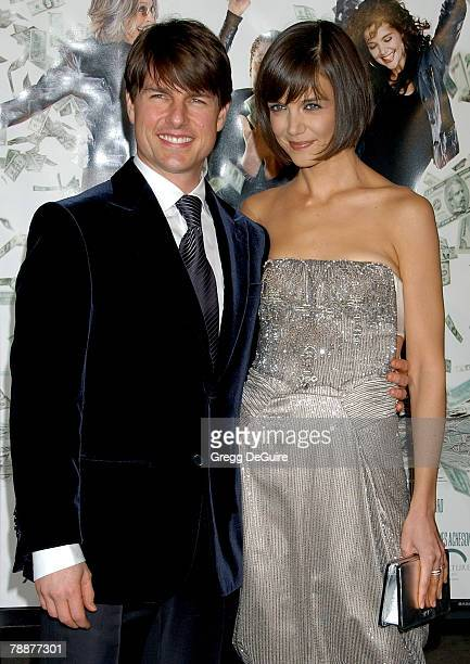 """Actor Tom Cruise and actress Katie Holmes arrive at the """"Mad Money"""" premiere at Mann Village Theater on January 9, 2008 in Westwood, California."""