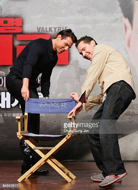 Actor Tom Cruise and director Bryan Singer check the chair during their press conference at the Hyatt hotel on January 18 2009 in Seoul South Korea...