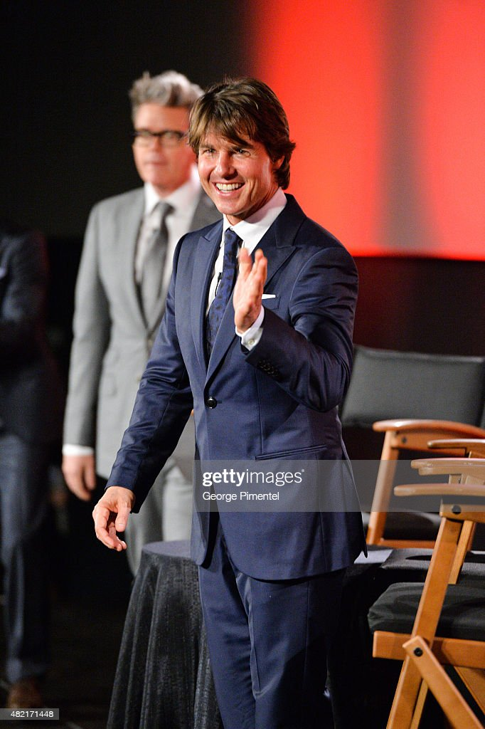Actor Tom Cruise and director Christopher McQuarrie attend the Canadian Fan Premiere of 'Mission: Impossible - Rogue Nation' at the Cineplex Scotiabank Theatre on July 27, 2015 in Toronto, Canada.