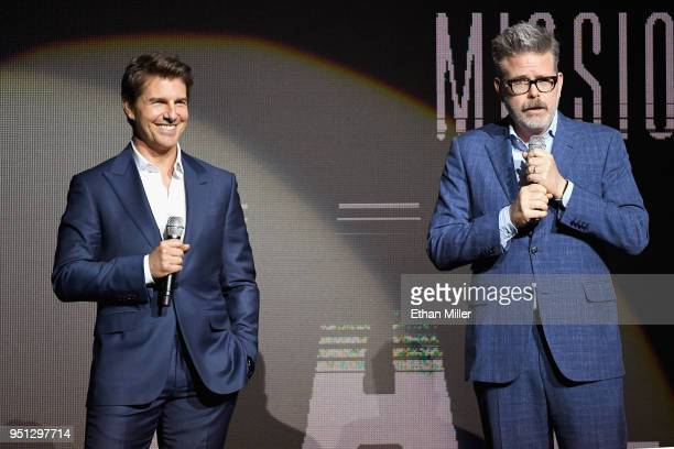 Actor Tom Cruise and director/writer/producer Christopher McQuarrie speak onstage during the CinemaCon 2018 Paramount Pictures Presentation...