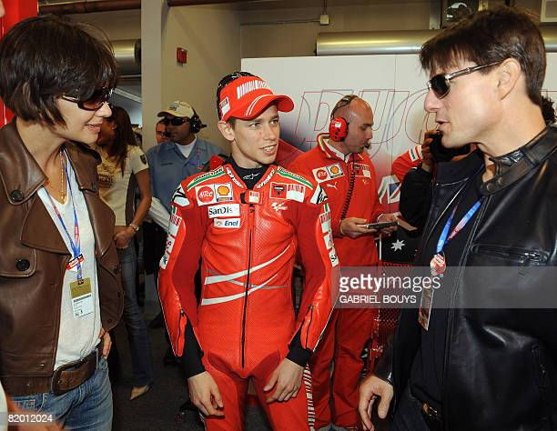 US actor Tom Cruise and his wife actress Katie Holmes meet Australian MotoGP rider Casey Stoner before the Red Bull US Grand Prix in Laguna Seca...