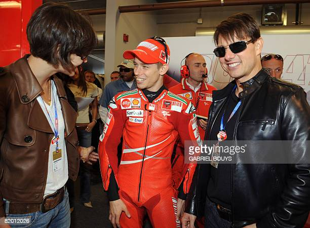 US actor Tom Cruise and his wife actress Katie Holmes meets Australian MotoGP rider Casey Stoner before the Red Bull US Grand Prix in Laguna Seca...