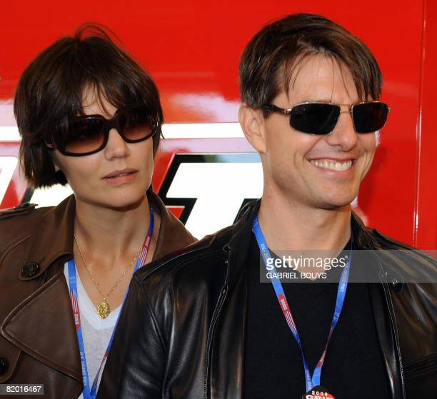 US actor Tom Cruise and his wife Katie Holmes look at Australian MotoGP rider Casey Stoner's Ducati before the Red Bull US Grand Prix in Laguna Seca...