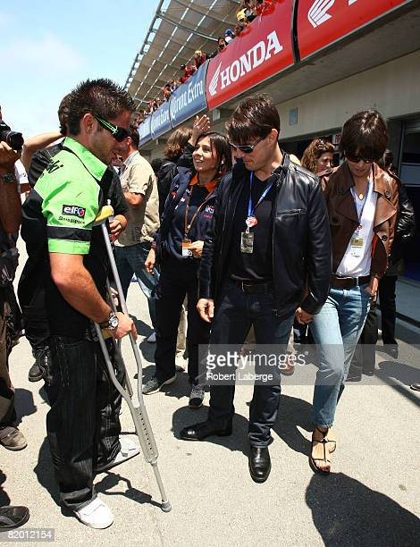 Actor Tom Cruise and his wife Katie Holmes meet John Hopkins rider of the Kawasaki before the start of the MotoGP Red Bull US Grand Prix at the Mazda...