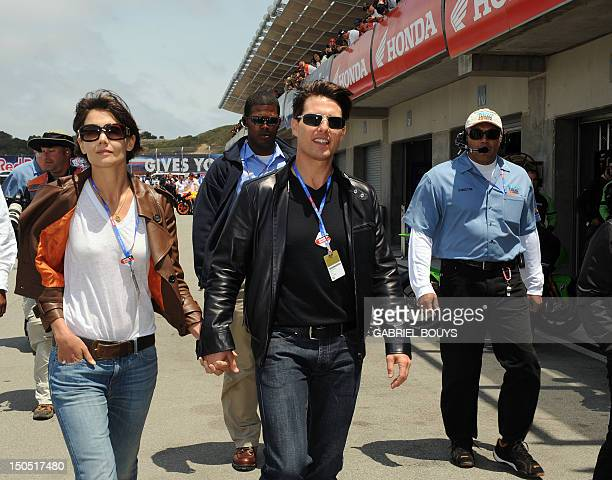 US actor Tom Cruise and his wife Katie Holmes visit the pits before the Red Bull US Grand Prix in Laguna Seca California July 20 2008 Rossi won the...