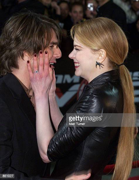 Actor Tom Cruise and his wife Nicole Kidman embrace each other at the Sydney premiere of 'Mission Impossible 2' May 30 2000 at Fox Studios in...